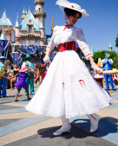 Anaheim, CA - August 10th 2016: Mary Poppins smiles at a young child as she leads a line of children in song and dance in front of Cinderella's castle during Disney's 60th Diamond Celebration.